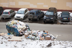 MOSCOW - APR 1: Scattered trash on the car parking in one of cou