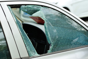 closeup of car window smashed by a thief