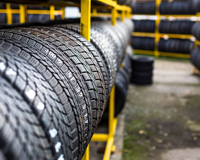 bigstock-tires-for-sale-at-a-tire-store-85240565